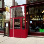 A winter vestibule enclosure for the Belgian Beer Cafe by NYC Signs & Awnings