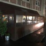A winter vestibule / seasonal enclosure by NYC Signs & Awnings