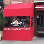A winter vestibule enclosure for Korchma Ukrainian Kitchen by NYC Signs & Awnings