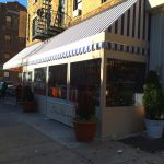 A winter vestibule enclosure for Positano's by NYC Signs & Awnings