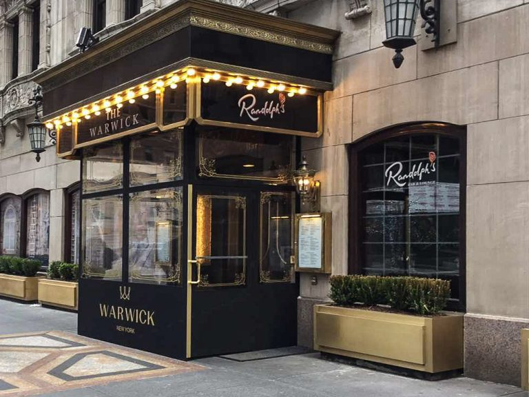 A winter vestibule/ seasonal enclosure for the Warwick by NYC Signs & Awnings