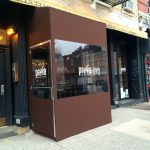 A winter vestibule enclosure for Prova by NYC Signs & Awnings
